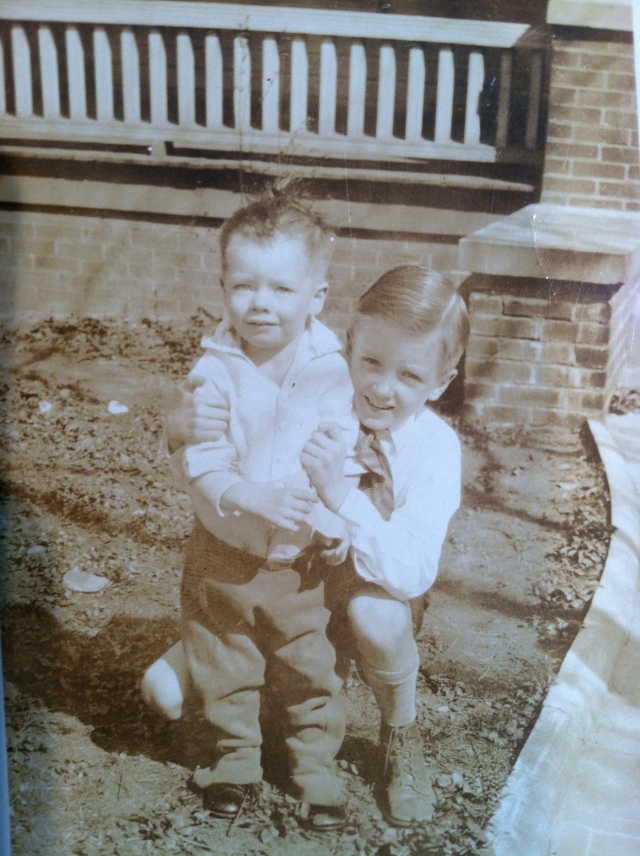 The birthday boy is standing.  His older brother Paul (1922-2010) crouches holding on....