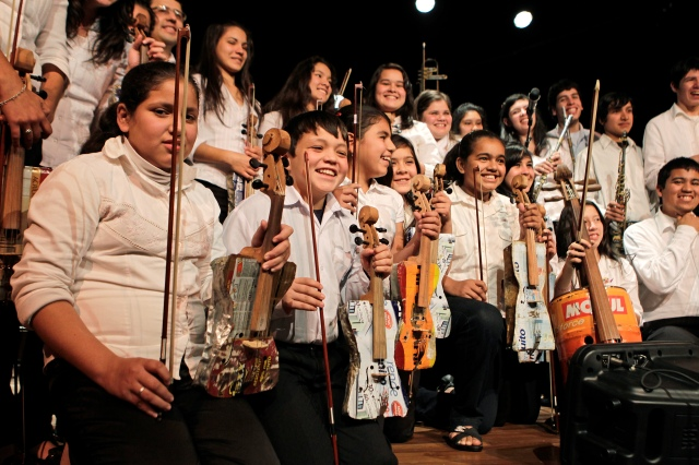 Members of the Orchestra of Recycled Instruments of Cateura pose for the audience during a concert in Asuncion